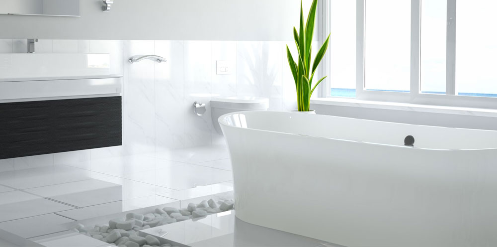 A white luxurious bath in a marbled environment