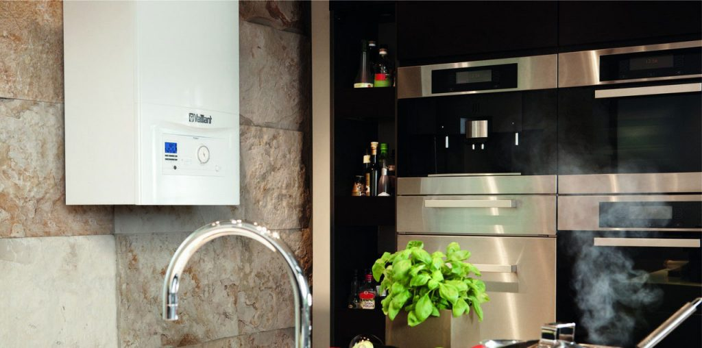 A Vaillant boiler fitted on a kitchen wall